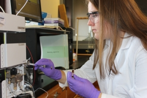 Meghan Guagenti studies St. John's Wort supplements as part of her summer research project.