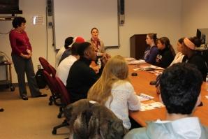 A USLI representative meets with students