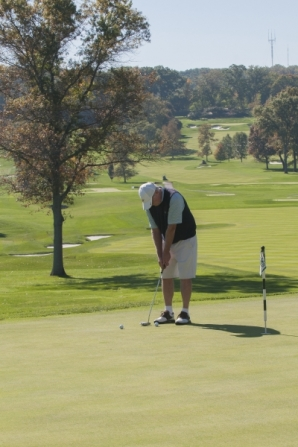 A golfer lines up a shot during the golf invitational.