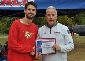 Giancarlo receives his Runner of the Year award from CACC Commissioner Dan Mara.