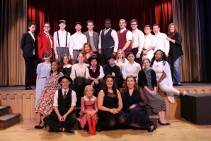 "The cast of ""It's a Wonderful Life"" poses with Jennifer Thorpe, advisor, on opening night."