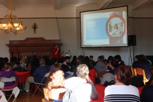 Eighth grade students listen to presentation about attending CHC.
