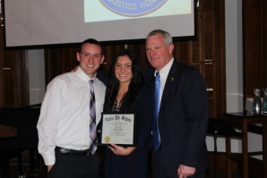 Justice Dougherty and his son Sean Dougherty '16, pose with Sean's girlfriend, Regina Trabosh '17, one of the new inductees into Nu Epsilon.