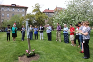 Students, faculty and staff gathered to pray at the Peace Pole.