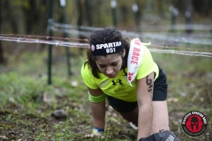 Layla Cruz '17 makes her way through the Barbed Wire Crawl portion of the race.
