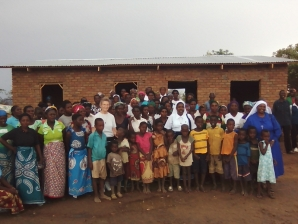 Sister Kathryn stands among some of the many people she visited in Africa.