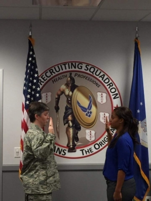 Brittany Russell, 5th year Psy.D. student, takes her oath as she is inducted into the U.S. Air Force.