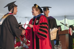 Sister Carol distributes degrees and congratulations.
