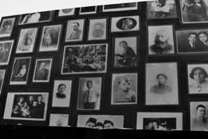 Photos belonging to the victims line the walls.