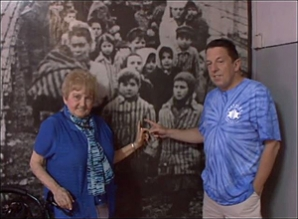 Eva and her son point to her photo as a young girl in Auschwitz.