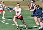 Captain Emorie Keimig '16 cradles the ball during the season opener against West Chester