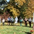 Members of the College community gather near the peace pole to pray.